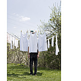 Young man, Hiding, Drying rack