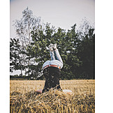 Young Woman, Field Stubble, Headstand